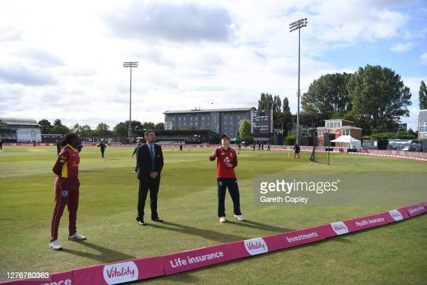 England captain Heather Knight tosses the coin alongside West Indies captain Stafanie Taylor and match referee Wayne Noon ahead the 3rd Vitality IT20...