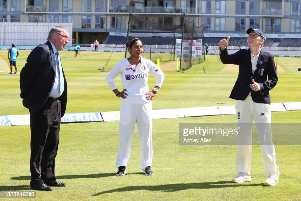 England captain Heather Knight tosses the coin as India's captain Mithali Raj looks on during Day One of the LV= Insurance Test Match between England...
