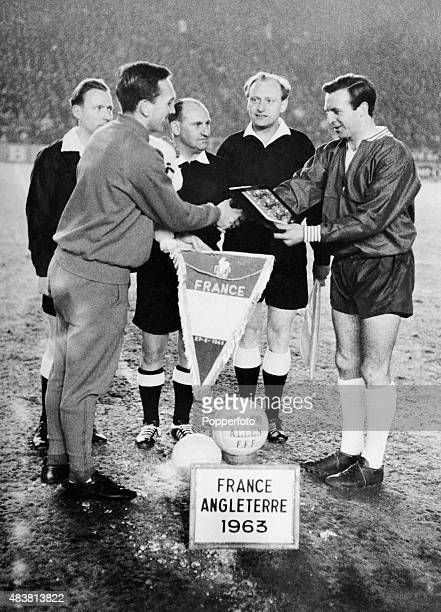 England captain Jimmy Armfield meets the captain of France Andre Lerond watched by the match officials prior to the European Championship 1st round...
