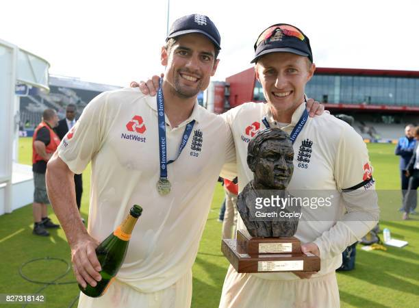 England captain Joe Root and Alastair Cook celebrate after winning the Investec Test series between England and South Africa at Old Trafford on...