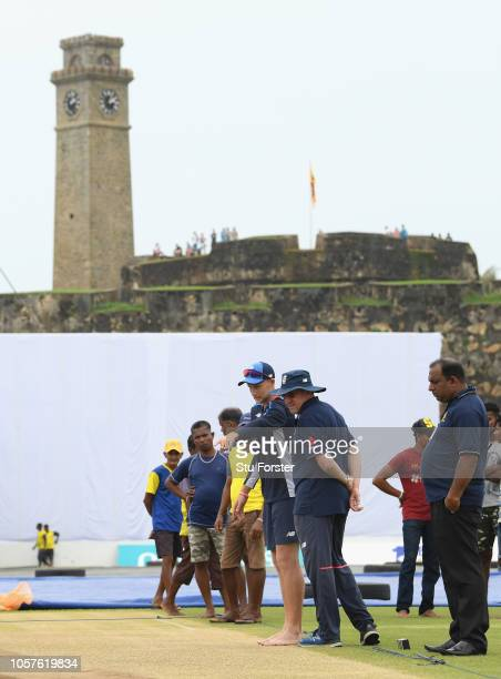 England captain Joe Root and coach Trevor Bayliss inspect the pitch before England Cricket Nets at Galle International Stadium ahead of the First...