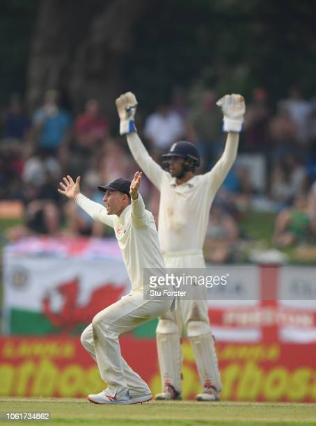 England captain Joe Root and keeper Ben Foakes appeal in vain for a catch during Day Two of the Second Test match between Sri Lanka and England at...