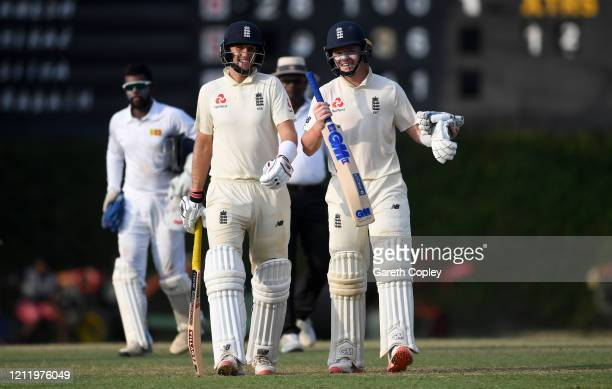 England captain Joe Root and Ollie Pope leave the field at stumps on day one of the tour match between SLC Board President's XI and England at P Sara...