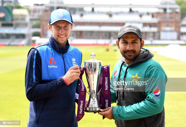 England captain Joe Root and Pakistan captain Sarfraz Ahmed hold the NatWest series trophy at Lord's Cricket Ground on May 23 2018 in London England