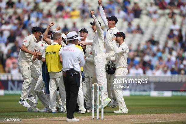 England captain Joe Root and players celebrate the review decision for the wicket of Ishant Sharma during day 4 of the First Specsavers Test Match...