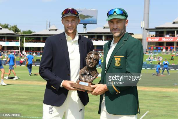 England captain Joe Root and South Africa captain Faf du Plessis with the series trophy during Day One of the First Test match between England and...