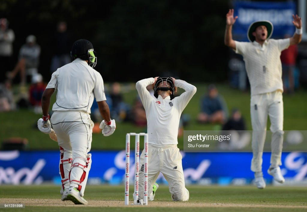 England captain Joe Root (c) and Stuart Broad (r) react as batsman Ish Sodhi survives a delivery from Mark Wood during day five of the Second Test Match between the New Zealand Black Caps and England at Hagley Oval on April 3, 2018 in Christchurch, New Zealand.