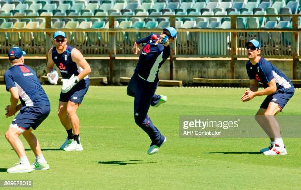 England captain Joe Root and teammates Mason Crane Jonny Bairstow and Alastair Cook take part in a training session at the WACA ground in Perth on...