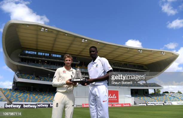 England captain Joe Root and West Indies captain Jason Holder pose with the Wisden Trophy before net practice at Kensington Oval on January 22, 2019...