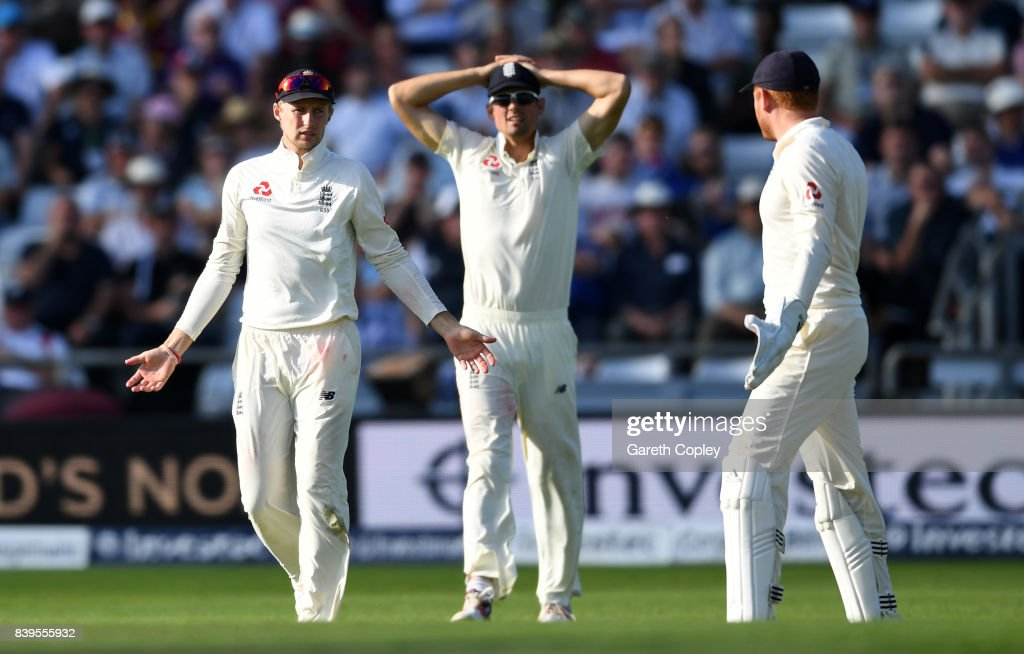 England captain Joe Root asks for a umpire review alongside Alastair Cook and Jonathan Bairstow during day two of the 2nd Investec Test between England and the West Indies at Headingley on August 26, 2017 in Leeds, England.
