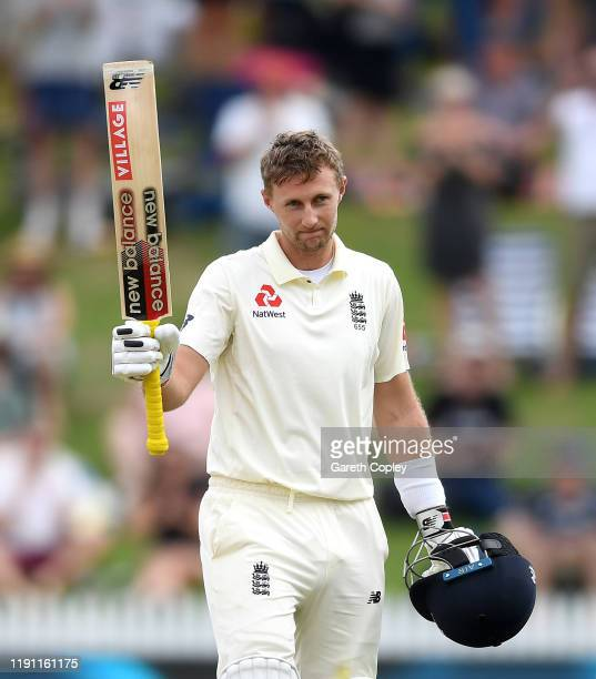 England captain Joe Root celebrates reaching his century during day 3 of the second Test match between New Zealand and England at Seddon Park on...