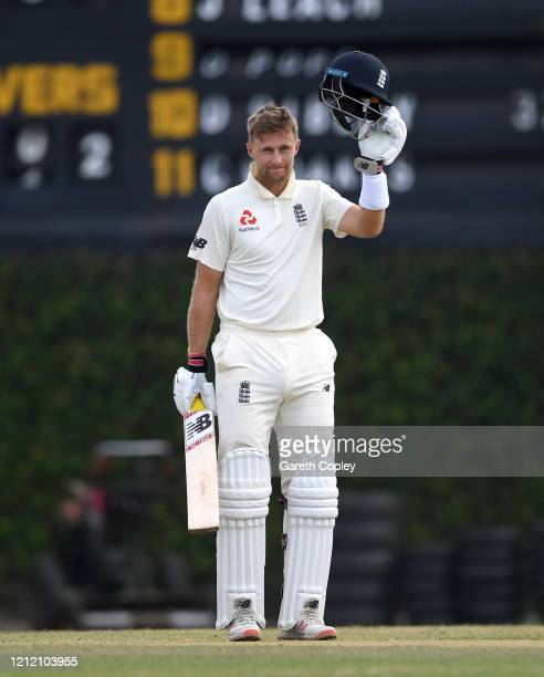 England captain Joe Root celebrates reaching his century during the tour match between SLC Board President's XI and England at P Sara Oval on March...