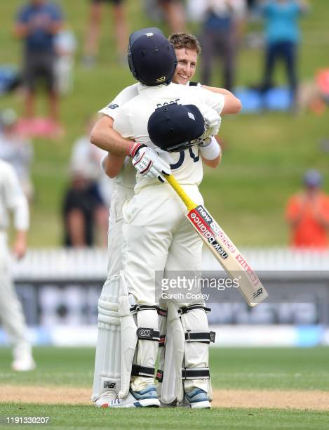 England captain Joe Root celebrates reaching his double century with Ollie Pope during day 4 of the second Test match between New Zealand and England...