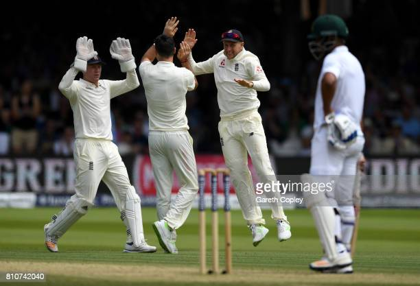 England captain Joe Root celebrates the wicket of Quinton de Kock of South Africa with James Anderson and Jonathan Bairstow during day three of the...