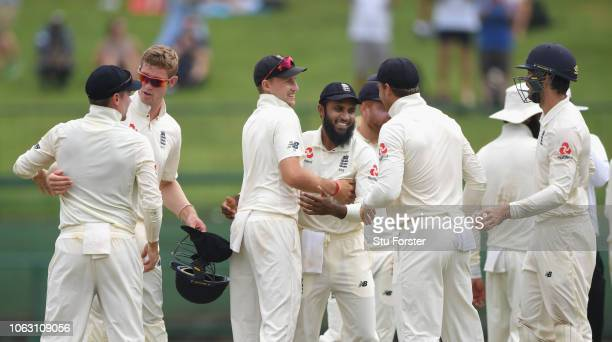England captain Joe Root celebrates with Adil Rashid and team mates after victory in the match and a 20 lead in the series during Day Five of the...