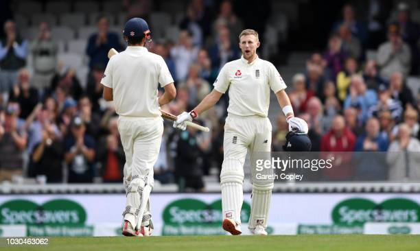 England captain Joe Root celebrates with Alastair Cook after reaching his century during day four of the Specsavers 5th Test match between England...