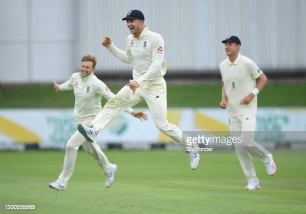England captain Joe Root celebrates with Joe Denly after taking the wicket of Quinton de Kock during Day Four of the Third Test between South Africa...