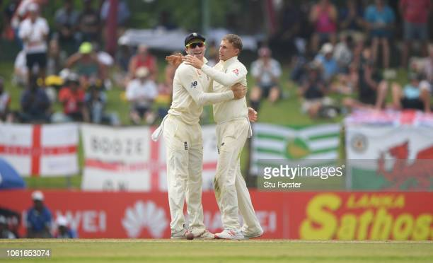 England captain Joe Root celebrates with Jos Buttler after dismissing Sri Lanka batsman Dickwella during Day Two of the Second Test match between Sri...
