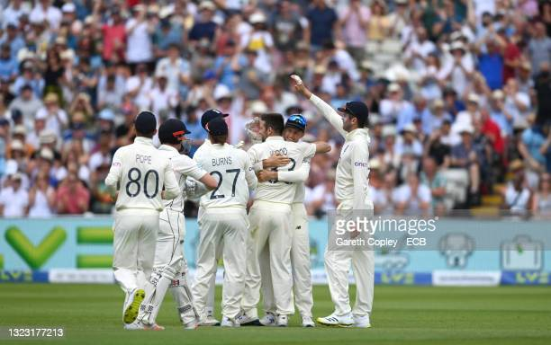 England captain Joe Root celebrates with team mates after Mark Wood had dismissed New Zealand batsman Henry Nicholls during day three of the second...