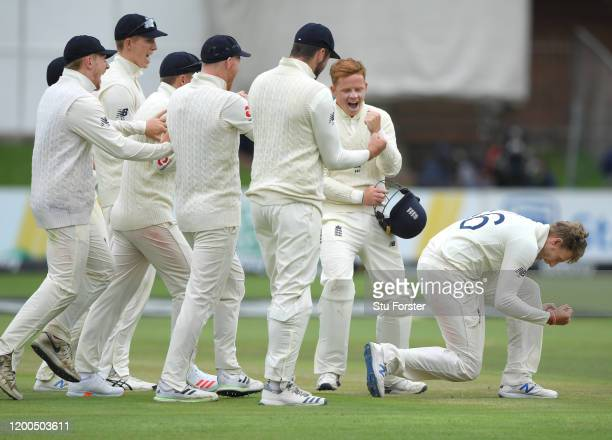 England captain Joe Root celebrates with team mates after taking the wicket of Pieter Malan after review during Day Four of the Third Test between...