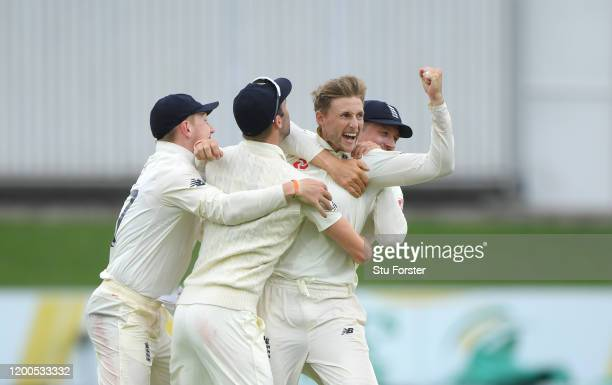 England captain Joe Root celebrates with team mates after taking the wicket of Rassie van der Dussen during Day Four of the Third Test between South...