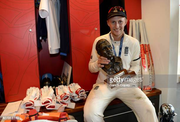England captain Joe Root celebrates with the series trophy in the dressing after winning the Investec Test series between England and South Africa at...