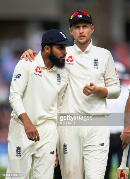 England captain Joe Root chats with Adil Rashid during day three of the Specsavers 3rd Test match between England and India at Trent Bridge on August...