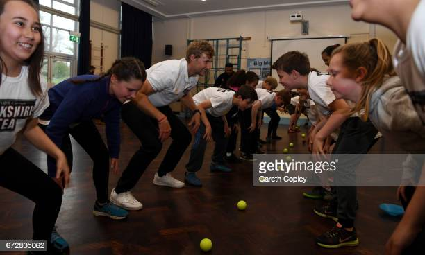 0d8a9ab5 England captain Joe Root coaches school children during a visit to his  former school Dore Primary