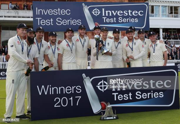 England captain Joe Root holds the Investec Trophy after England win the series 21 at the end of day three of the 3rd Investec Test match between...