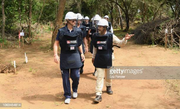 England captain Joe Root in demining personal protective equipment on a tour of a previously cleared area of mine site during the England Cricket...