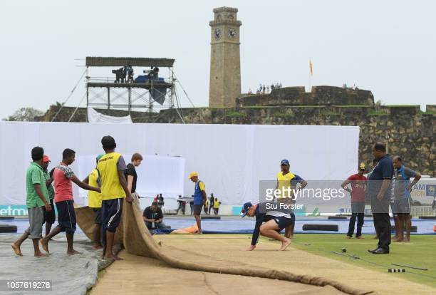 England captain Joe Root inspects the wicket before England Cricket Nets at Galle International Stadium ahead of the First Test Match on November 5,...