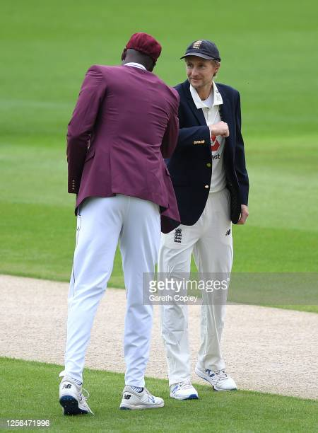 England captain Joe Root interacts with West Indies captain Jason Holder at the toss prior to Day One of the 2nd Test Match in the #RaiseTheBat...