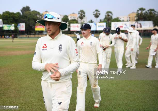 England captain Joe Root leads his team from the field after the tour match between SLC Board President's XI and England abandoned at P Sara Oval on...
