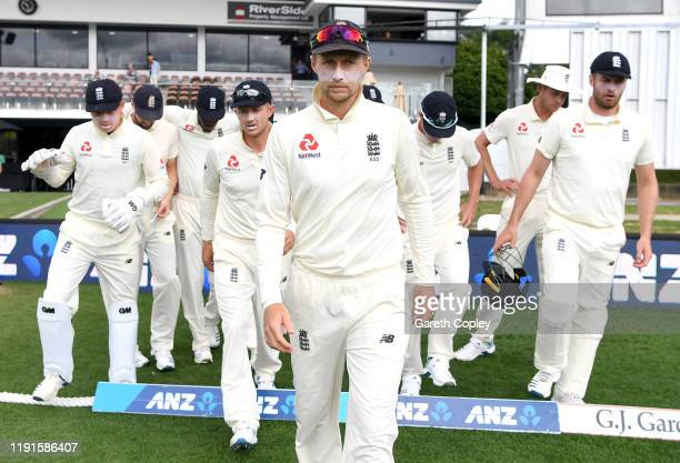 England captain Joe Root leads out his team ahead of day 5 of the second Test match between New Zealand and England at Seddon Park on December 03...