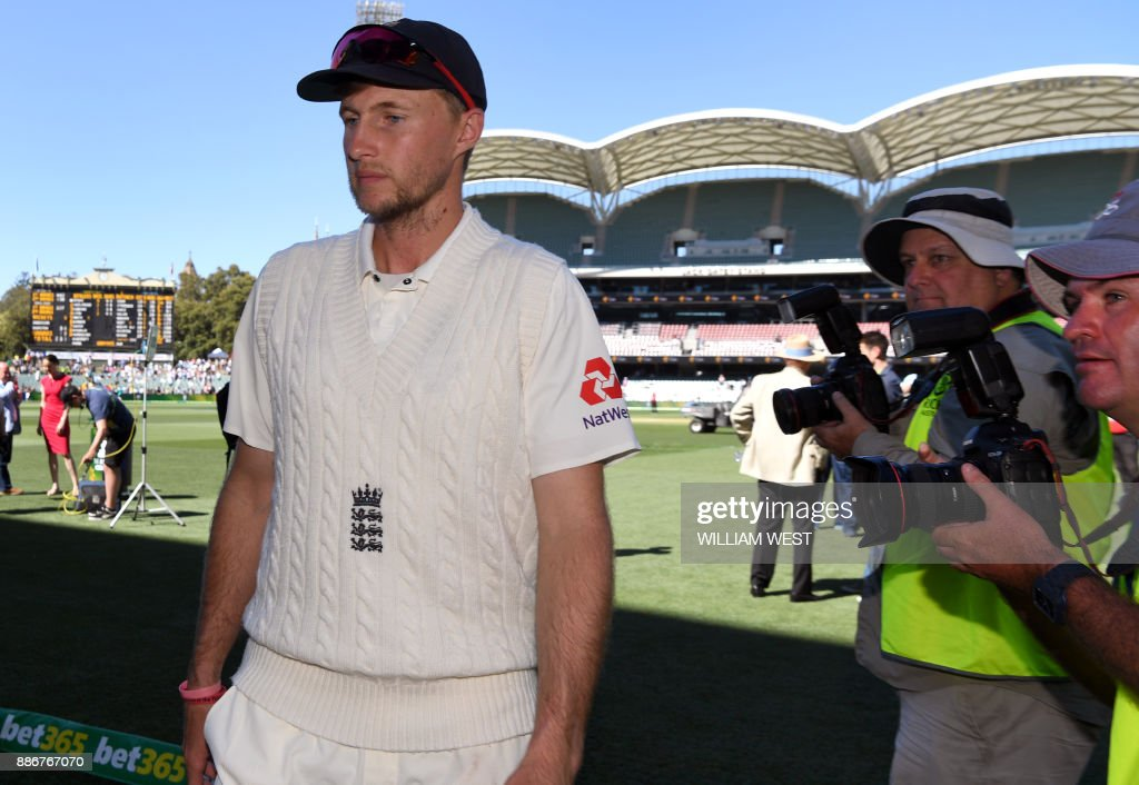 England captain Joe Root leaves the field after Australia defeated England on the final day of the second Ashes cricket Test match in Adelaide in December 6, 2017. /