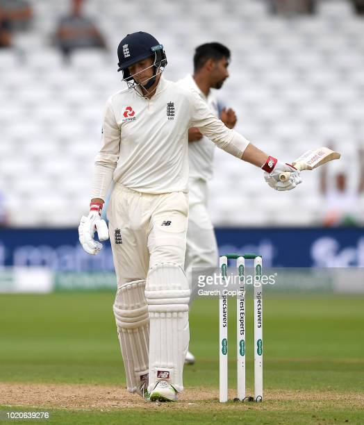 England batsman Jos Buttler drives a ball to the boundary watched by wicketkeeper Pant during day four of the 3rd Specsavers Test Match between...