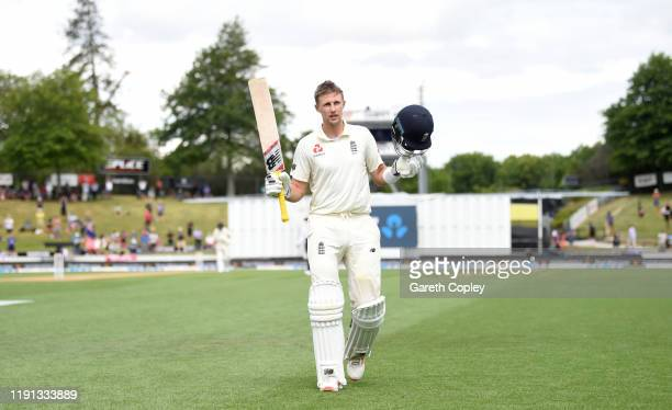 England captain Joe Root leaves the field after being dismissed by Mitchell Santner of New Zealand during day 4 of the second Test match between New...