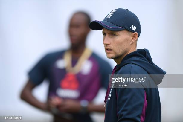 England captain Joe Root looks on as Jofra Archer prepares to bowl during England nets ahead of the 4th Test match at Emirates Old Trafford on...