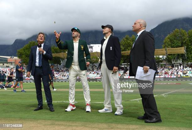 England captain Joe Root looks on as South Africa captain Faf du Plessis tosses the coin before Day One of the Second Test between England and South...