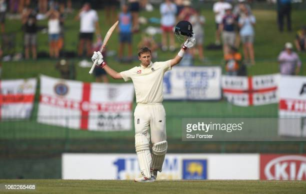 England captain Joe Root raises his bat to the crowd after reaching his century during Day Three of the Second Test match between Sri Lanka and...