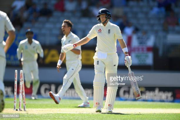 England captain Joe Root reacts after being bowled by Trent Boult for 0 during the First Test Match between the New Zealand Black Caps and England at...