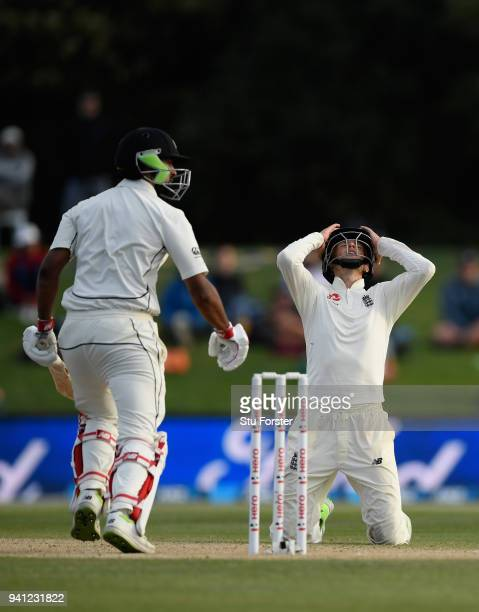 England captain Joe Root reacts as batsman Ish Sodhi survives a delivery from Mark Wood during day five of the Second Test Match between the New...