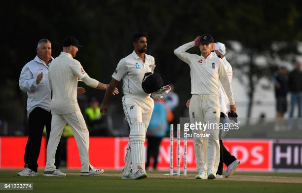 England captain Joe Root reacts as New Zealand match saving batsman Ish Sodhi looks on as the match is called a draw after day five of the Second...