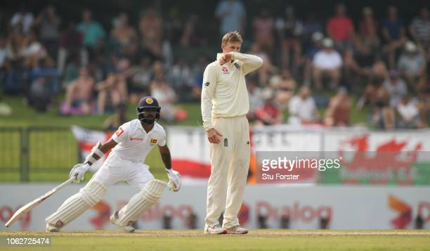 England captain Joe Root reacts as Sri Lanka batsman Niroshan Dickwella picks up a boundary during Day Four of the Second Test match between Sri...