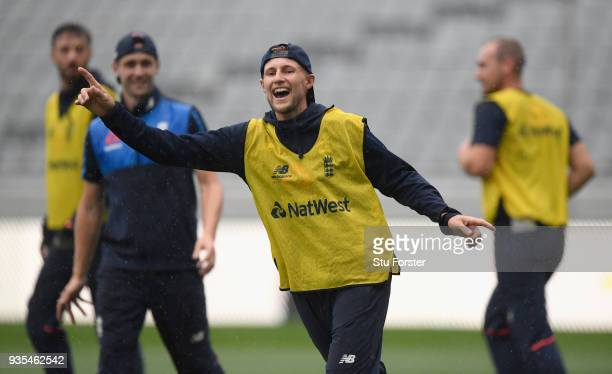England captain Joe Root reacts during a game of Football in the rain during England nets ahead of the 1st Test Match against the New Zealand Black...