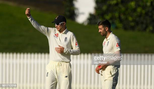 England captain Joe Root sets his field with bowler Mark Wood during day one of the Test warm up match between England and New Zealand Cricket XI at...