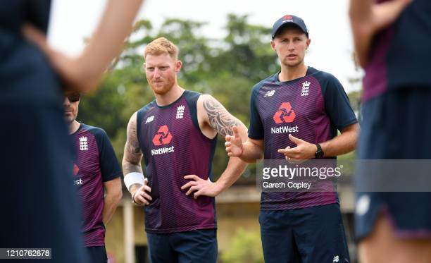 England captain Joe Root speaks to his team alongside Ben Stokes during a nets session at Chilaw Marians Cricket Club Ground on March 06 2020 in...