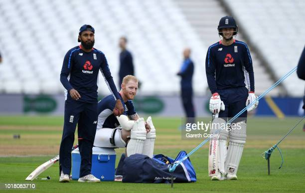 England captain Joe Root speaks with Ben Stokes and Adil Rashid during a nets session at Trent Bridge on August 17 2018 in Nottingham England