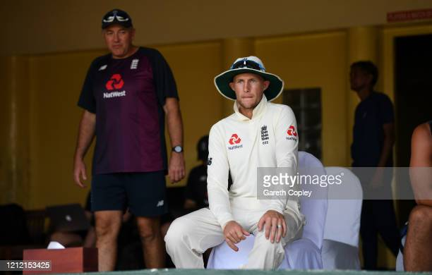 England captain Joe Root speaks with coach Chris Silverwood ahead of the tour match being abandoned between SLC Board President's XI and England at P...