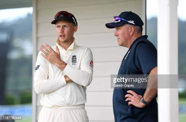 England captain Joe Root speaks with coach Chris Silverwood during day one of the tour match between New Zealand XI and England at Cobham Oval on...